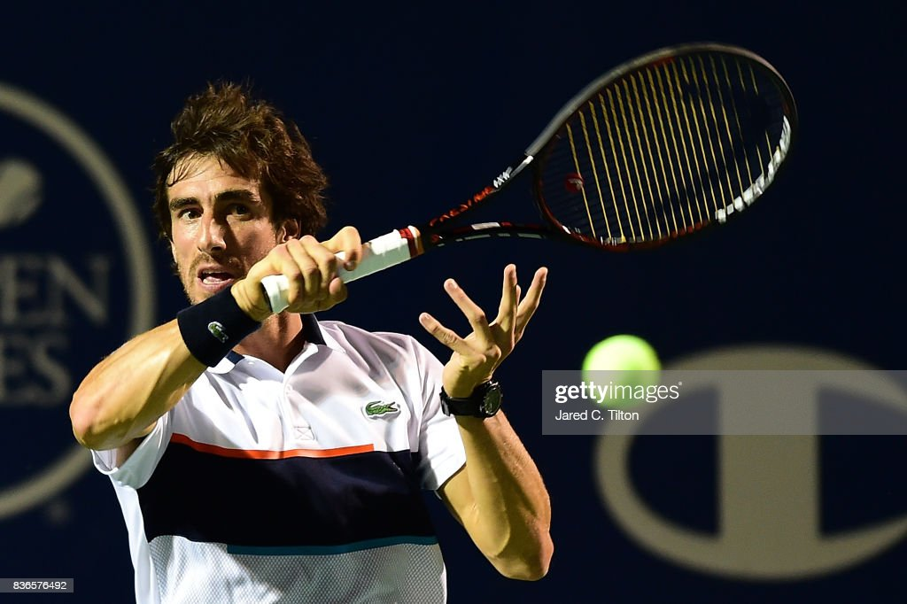 Pablo Cuevas of Uruguay returns a shot from Jan-Lennard Struff of Germany during the third day of the Winston-Salem Open at Wake Forest University on August 21, 2017 in Winston Salem, North Carolina.