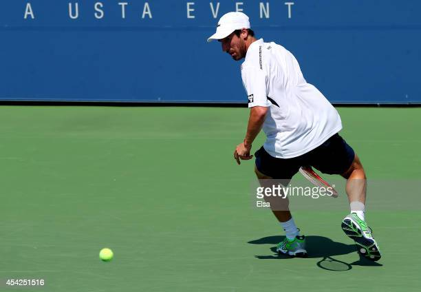 Pablo Cuevas of Uruguay returns a shot through his legs against Kevin Anderson of South Africa during their men's signles first round match on Day...