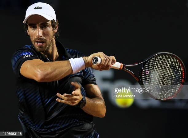 Pablo Cuevas of Uruguay returns a shot to Felix Auger-Aliassime of Canada during the singles semi final of the ATP Rio Open 2019 at Jockey Club...