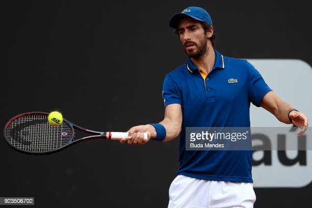 Pablo Cuevas of Uruguay returns a shot to Nicolas Jarry of Chile during the quarter finals of the ATP Rio Open 2018 at Jockey Club Brasileiro on...