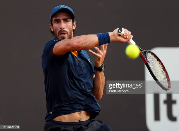 Pablo Cuevas of Uruguay returns a shot to Thiago Monteiro of Brazil during the ATP Rio Open 2018 at Jockey Club Brasileiro on February 20 2018 in Rio...