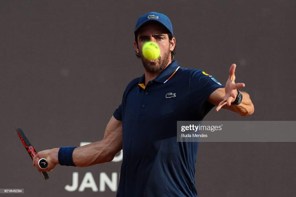 Pablo Cuevas of Uruguay returns a shot to Thiago Monteiro of Brazil during the ATP Rio Open 2018 at Jockey Club Brasileiro on February 20, 2018 in Rio de Janeiro, Brazil.