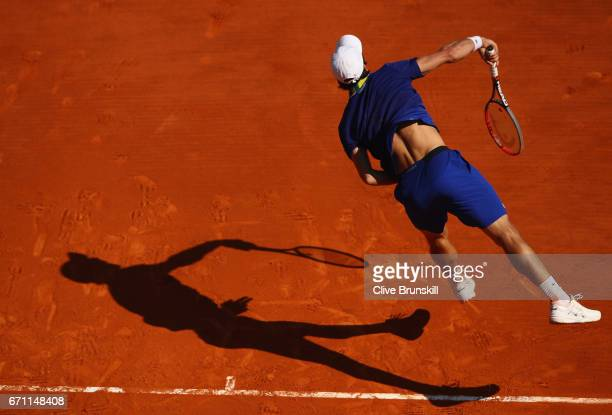 Pablo Cuevas of Uruguay serves against Lucas Pouille of France in their quarter final round match on day six of the Monte Carlo Rolex Masters at...