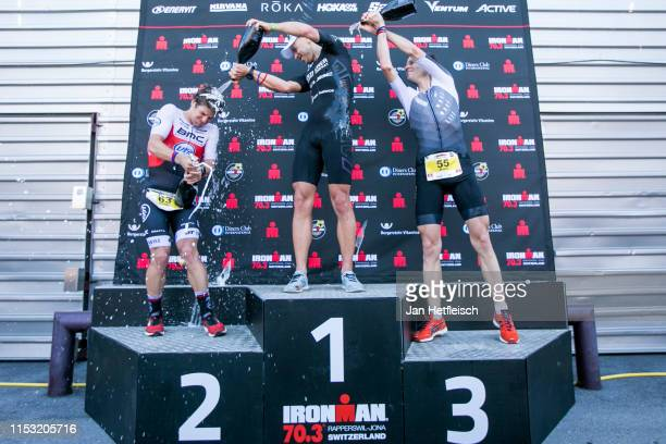 Pablo Danepa Gonzalez of Spain Andi Boecherer of Germany and Sven Riederer of Switzerland during the flower ceremony of the IRONMAN 703 Rapperswil on...