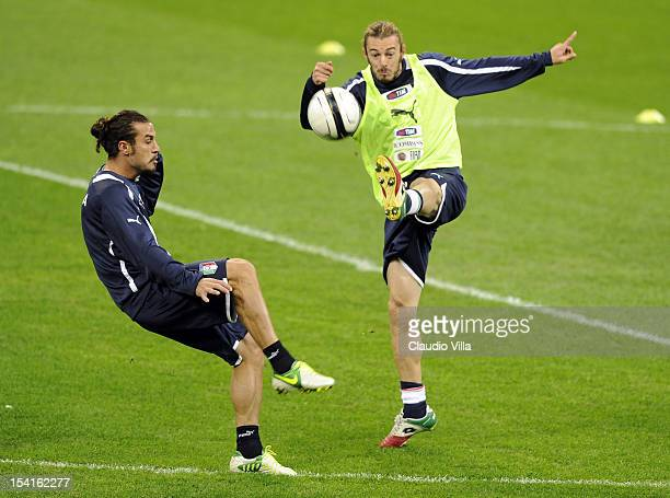Pablo Daniel Osvaldo and Federico Balzaretti of Italy attend a training session ahead of their FIFA World Cup Brazil 2014 qualifier against Danimarca...