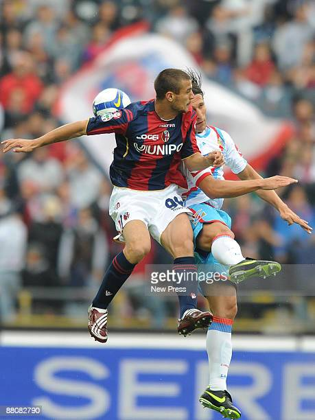 Pablo Daniel Osvaldo of Bologna and Matias Silvestre of Catania compete for a header during the Serie A match between Bologna FC and Calcio Catania...