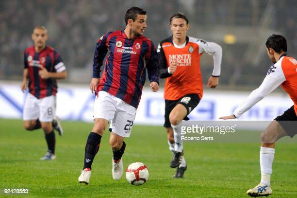 Pablo Daniel Osvaldo of Bologna FC competes with Albin Ekdal of AC Siena during the match of Serie A between Bologna FC and AC Siena at Stadio Renato...