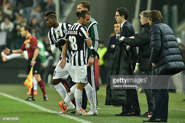 Pablo Daniel Osvaldo of Juventus is replaced by Paul Pogba during the UEFA Europa League Round of 16 match between Juventus and ACF Fiorentina at...