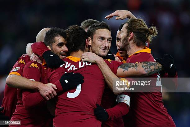 Pablo Daniel Osvaldo with his teammates of AS Roma celebrates after scoring his fourth team's goal during the Serie A match between AS Roma and ACF...