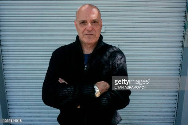 Pablo De Biase who is currently unemployed poses during an interview with AFP in Buenos Aires on October 02 2018 A laboratory a textile and a...