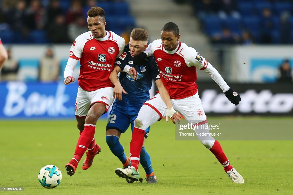 Pablo de Blasis (C) of Hoffenheim fights for the ball with Jean-Philippe Gbamin (L) and Abdou-Lakhad Diallo (R) of Mainz during the Bundesliga match between TSG 1899 Hoffenheim and 1. FSV Mainz 05 at Wirsol Rhein-Neckar-Arena on February 10, 2018 in Sinsheim, Germany.