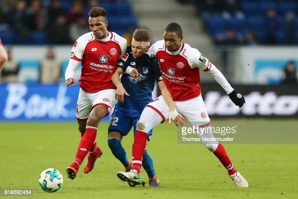 Pablo de Blasis of Hoffenheim fights for the ball with JeanPhilippe Gbamin and AbdouLakhad Diallo of Mainz during the Bundesliga match between TSG...