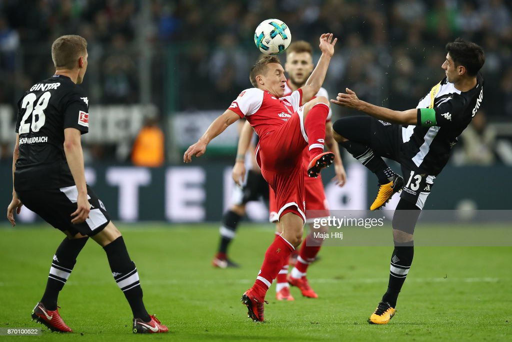 Pablo de Blasis of Mainz (l) and Lars Stindl of Moenchengladbach fight for the ball during the Bundesliga match between Borussia Moenchengladbach and 1. FSV Mainz 05 at Borussia-Park on November 4, 2017 in Moenchengladbach, Germany.