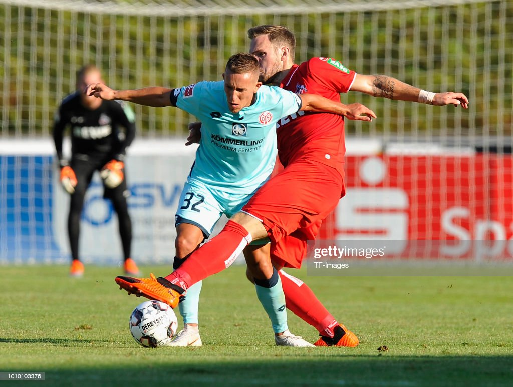 Pablo de Blasis of Mainz and Rafael Czichos of Koeln battle for the ball during the pre-season friendly match between 1. FC Koeln and 1. FSV Mainz 05 at Sportpark Nord on July 27, 2018 in Bonn, Germany.