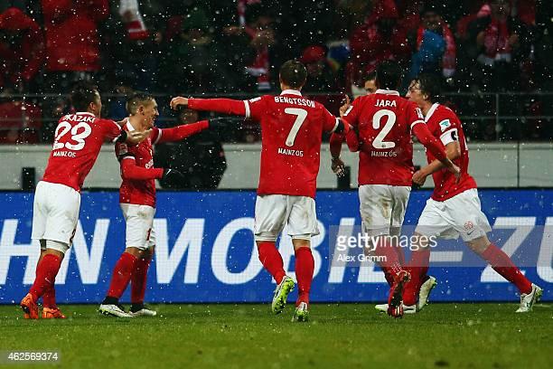 Pablo de Blasis of Mainz celebrates his team's third goal with team mates during the Bundesliga match between 1 FSV Mainz 05 and SC Paderborn at...