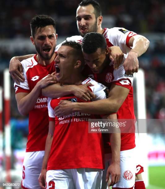 Pablo de Blasis of Mainz celebrates scoring the penalty goal with teamates during the Bundesliga match between 1 FSV Mainz 05 and SportClub Freiburg...