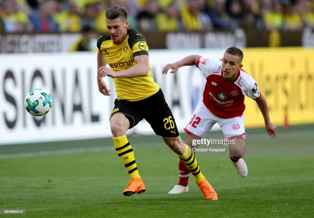 Pablo de Blasis of Mainz (R) challenges Lukasz Piszczek of Dortmund (L) during the Bundesliga match between Borussia Dortmund and 1. FSV Mainz 05 at Signal Iduna Park on May 5, 2018 in Dortmund, Germany.