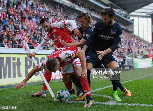 Pablo de Blasis of Mainz defends the ball against Valentin Stocker of Berlin and Marvin Plattenhardt of Berlin during the Bundesliga match between 1...
