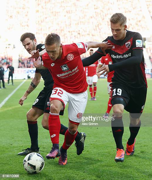 Pablo de Blasis of Mainz is challenged by Pascal Gross and Max Christiansen of Ingolstadt during the Bundesliga match between 1 FSV Mainz 05 and FC...