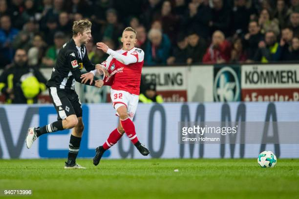 Pablo De Blasis of Mainz is fouled by Christoph Kramer of Moenchengladbach during the Bundesliga match between 1 FSV Mainz 05 and Borussia...