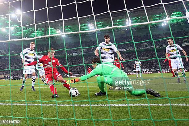 Pablo de Blasis of Mainz scores a disallowed goal past goalkeeper Yann Sommer of Moenchengladbach during the Bundesliga match between Borussia...