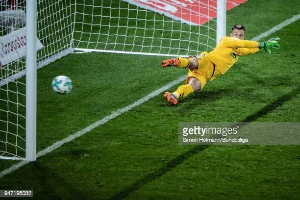 Pablo De Blasis of Mainz scores his side's first goal past gooalkeeper Alexander Schwolow of Freiburg during the Bundesliga match between 1 FSV Mainz...