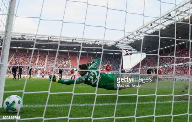 Pablo de Blasis of Mainz scores his team's first goal by penalty against goalkeeper Rune Jarstein of Berlin during the Bundesliga match between 1 FSV...