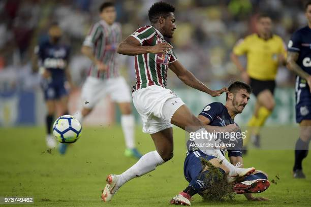 Pablo Dyego of Fluminense struggles for the ball with Gustavo Henrique of Santos during the match between Fluminense and Santos as part of...