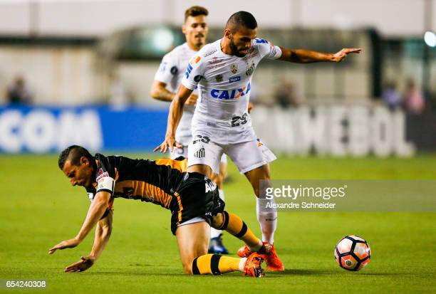 Pablo Escobar L0 of The Strongest and Thiago Maia of Santos in action during the match between Santos of Brazil and The Strongest of Bolivia for the...
