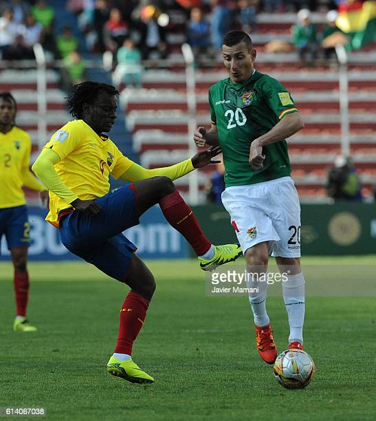 Pablo Escobar of Bolivia and Juan Carlos Paredes of Ecuador fight for the ball during a match between Bolivia and Ecuador as part of FIFA 2018 World...