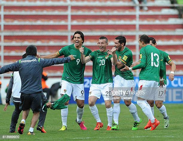 Pablo Escobar of Bolivia celebrates with teammates after scoring the opening goal during a match between Bolivia and Ecuador as part of FIFA 2018...