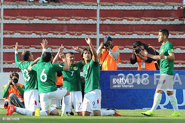 Pablo Escobar of Bolivia celebrates with teammates after scoring the second goal of his team during a match between Bolivia and Ecuador as part of...
