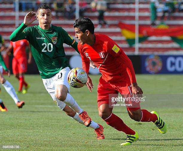 Pablo Escobar of Bolivia fights for the ball with Luis Abram of Peru during a match between Bolivia and Peru as part of FIFA 2018 World Cup...