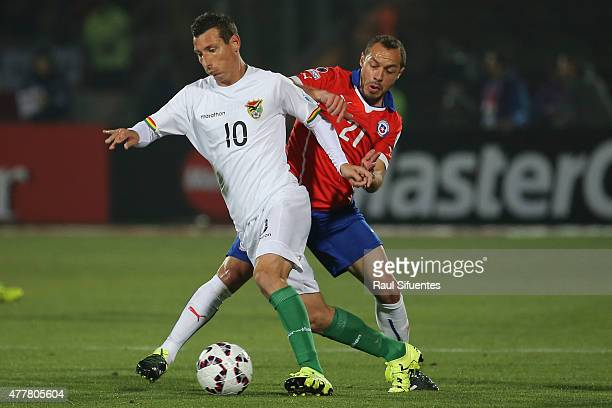 Pablo Escobar of Bolivia fights for the ball with Marcelo Diaz of Chile during the 2015 Copa America Chile Group A match between Chile and Bolivia at...
