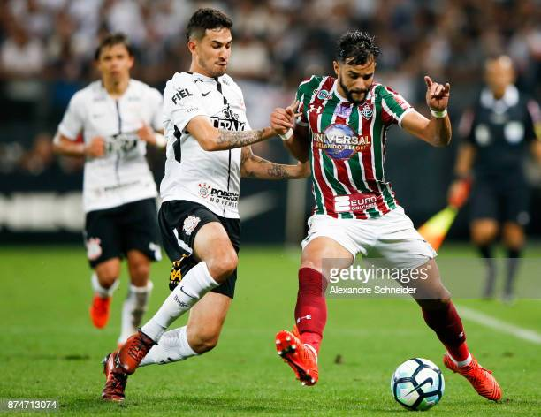Pablo Escobar of Corinthians and Xina of Fluminense in action during the match for the Brasileirao Series A 2017 at Arena Corinthians Stadium on...