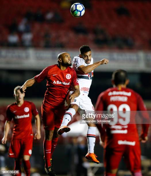 Pablo Escobar of Sao Paulo and China of Internacional in action during the match between Sao Paulo and Internacional for the Brasileirao Series A...