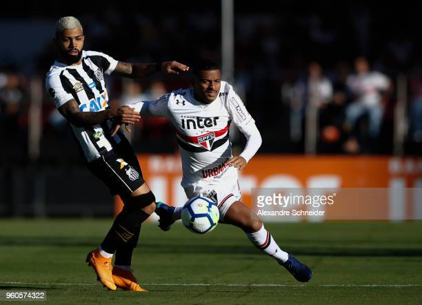 Pablo Escobar of Sao Paulo and China of Santos in action during the match between Sao Paulo and Santos for the Brasileirao Series A 2018 at Morumbi...