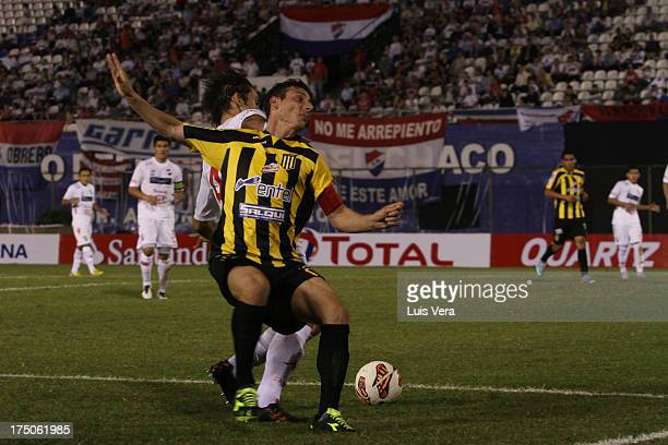 Pablo Escobar of The Stongest and Raul Piris of Nacional fight for the ball with during a match between Nacional and The Stongest as part of the Copa...