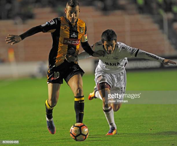 Pablo Escobar of The Strongest and Matias Rojas of Lanus fight for the ball during a first leg match between The Strongest and Lanus as part of Copa...