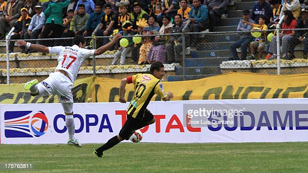 Pablo Escobar of The Strongest competes for the ball with Carlos Peralta of Club Nacional during a match between The Strongest and Club Nacional as...