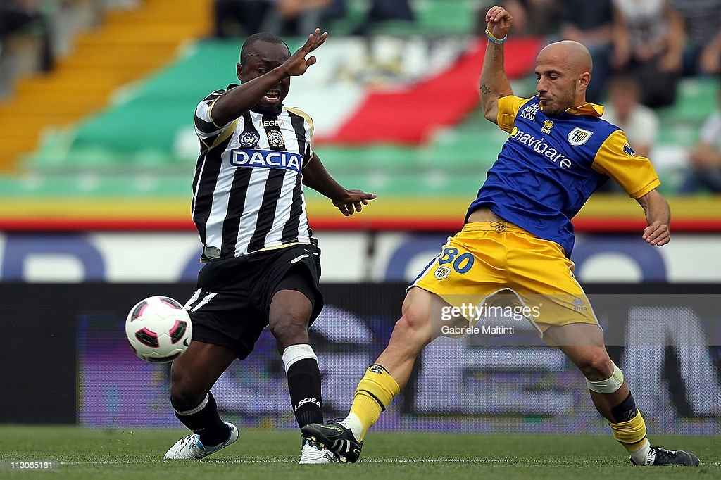 Pablo Estifer Armero of Udinese Calcio fights for the ball with Francesco Valiani of Parma FC during the Serie A match between Udinese Calcio and Parma FC at Stadio Friuli on April 23, 2011 in Udine, Italy.
