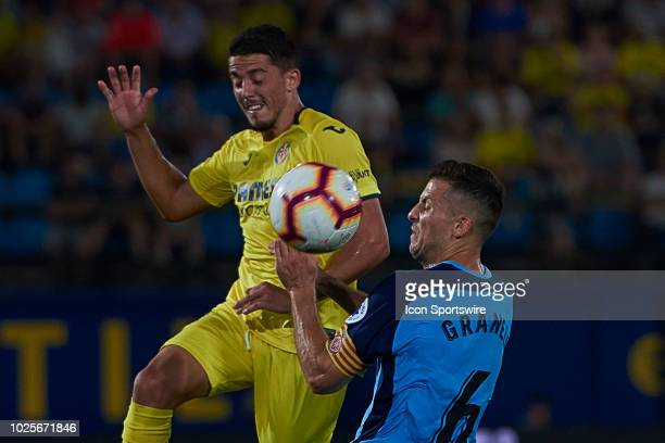 Pablo Fornals midfielder of Villarreal CF competes for the ball with Alex Granell midfielder of Girona FC during the La Liga match between Villarreal...