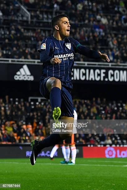 Pablo Fornals of Malaga CF celebrates after scoring his team's first goal during the La Liga match between Valencia CF and Malaga CF at Mestalla...