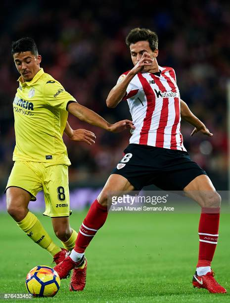 Pablo Fornals of Villarreal CF competes for the ball with Ander Iturraspe of Athletic Club during the La Liga match between Athletic Club Bilbao and...
