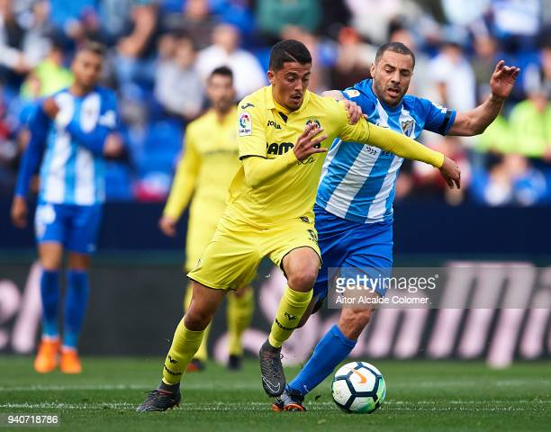 Pablo Fornals of Villarreal CF competes for the ball with Medhi Lacen of Malaga CF during the La Liga match between Malaga and Villarreal at Estadio...