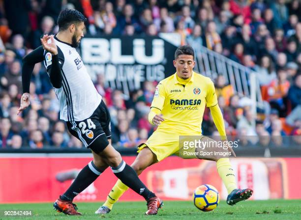 Pablo Fornals of Villarreal CF fights for the ball with Ezequiel Garay of Valencia CF during the La Liga 201718 match between Valencia CF and...