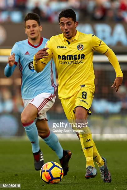 Pablo Fornals of Villarreal CF is challenged by Nemanja Radoja of Celta de Vigo during the La Liga match between Celta de Vigo and Villarreal at...