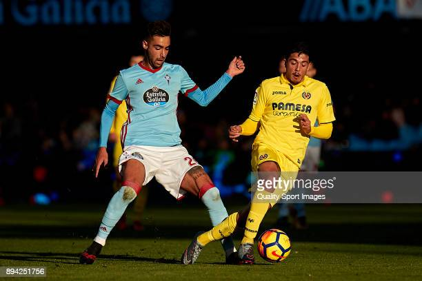 Pablo Fornals of Villarreal CF is challenged by Pablo 'Tucu' Hernandez of Celta de Vigo during the La Liga match between Celta de Vigo and Villarreal...