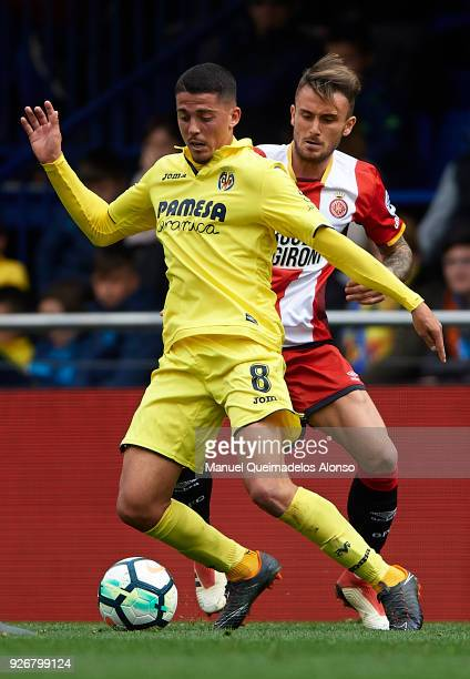Pablo Fornals of Villarreal competes for the ball with Aleix Garcia of Girona during the La Liga match between Villarreal and Girona at Estadio de La...