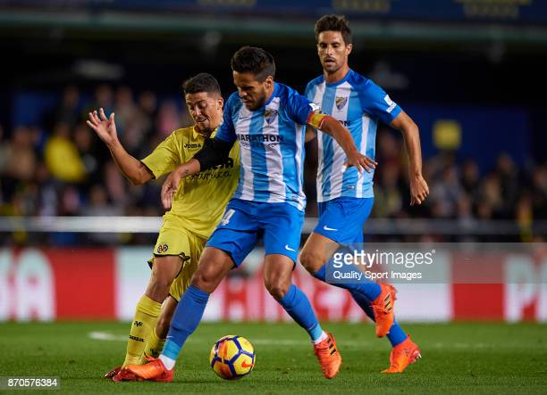 Pablo Fornals of Villarreal competes for the ball with Jose Luis Garcia of Malaga during the La Liga match between Villarreal and Malaga at Estadio...